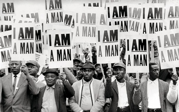 "The march led by Dr. Martin Luther King Jr. went forward March 28. Most of the 5,000-plus who participated were described as working-class, church-going people who donned their Sunday best because they believed in the righteousness of the strike and they believed in King. The ""I Am A Man"" signs distributed that day came to symbolize the strike effort. Photo by Richard L Copley."