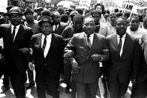 Martin Luther King, Jr., marching with Rev. Ralph Abernathy, right, and Bishop Julian Smith, left, in Memphis, Tenn., March 28, 1968.